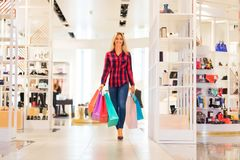 Young woman with shopping bags in the fashion store Royalty Free Stock Images
