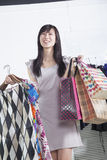 Young woman with shopping bags at fashion store Stock Photos