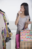 Young woman with shopping bags at fashion store Stock Images