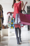 Young woman with shopping bags at fashion store Royalty Free Stock Photo