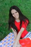 Young Woman with Shopping Bags and Grass Royalty Free Stock Images