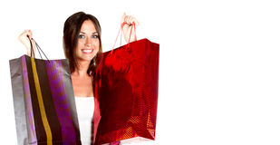 Young woman with shopping bags in hands Royalty Free Stock Photos