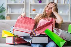 The young woman with shopping bags indoors home on sofa. Young woman with shopping bags indoors home on sofa stock photo