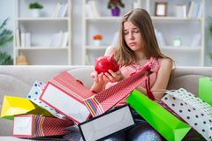 The young woman with shopping bags indoors home on sofa. Young woman with shopping bags indoors home on sofa Royalty Free Stock Photos