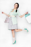 Young woman with shopping bags on isolated background Royalty Free Stock Photos