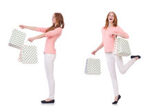 The young woman with shopping bags isolated on white Royalty Free Stock Photos