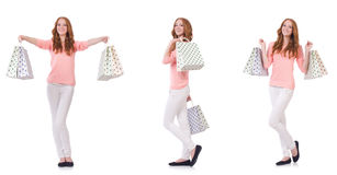 The young woman with shopping bags isolated on white Stock Images