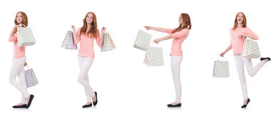 The young woman with shopping bags isolated on white Royalty Free Stock Images