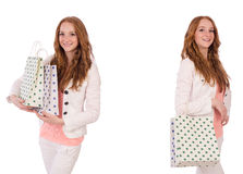 The young woman with shopping bags isolated on white Royalty Free Stock Photo