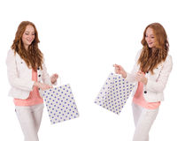 The young woman with shopping bags isolated on white Royalty Free Stock Image