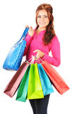 Young woman with shopping bags isolated on white Stock Photography
