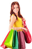 Young woman with shopping bags isolated on white Royalty Free Stock Photo