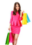 Young woman with shopping bags isolated on white Royalty Free Stock Images