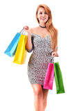 Young woman with shopping bags isolated on white Stock Image