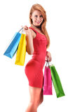 Young woman with shopping bags isolated on white Royalty Free Stock Photography