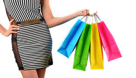 Young woman with shopping bags isolated on white Stock Photos