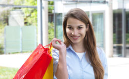 Young woman with shopping bags looking at camera Royalty Free Stock Image