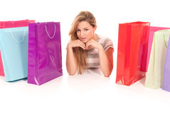 Young woman with shopping bags lying Stock Photo