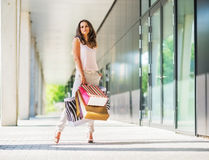 Young woman with shopping bags on the mall alley Royalty Free Stock Images