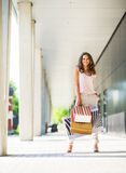 Young woman with shopping bags on the mall alley Stock Image