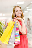 Young woman with shopping bags in mall Royalty Free Stock Photography