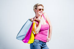 Young woman with shopping bags over her shoulder Royalty Free Stock Photos