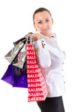 Young woman with shopping bags over white Stock Image