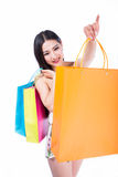 Young woman with shopping bags over white backgrou Royalty Free Stock Photography