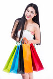 Young woman with shopping bags over white backgrou Royalty Free Stock Photos