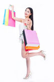 Young woman with shopping bags over white backgrou Stock Photo