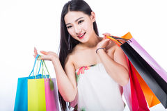 Young woman with shopping bags over white backgrou Stock Image