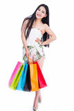 Young woman with shopping bags over white backgrou Stock Images