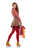Young woman with shopping bags over white Royalty Free Stock Photos