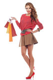 Young woman with shopping bags over white Stock Images
