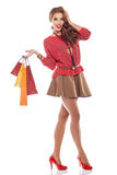 Young woman with shopping bags over white Stock Photo