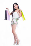 Young woman with shopping bags over white background Royalty Free Stock Images