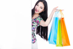 Young woman with shopping bags over white background Stock Photo