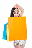 Young woman with shopping bags over white background Stock Photography