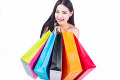 Young woman with shopping bags over white background Stock Image
