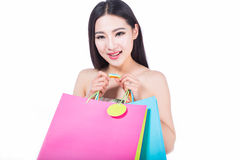 Young woman with shopping bags over white background Stock Photos