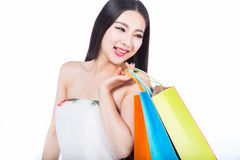 Young woman with shopping bags over white background Royalty Free Stock Photography