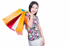 Young woman with shopping bags over white background Stock Images
