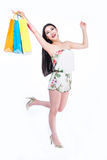 Young woman with shopping bags over white background Royalty Free Stock Photos