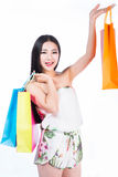 Young woman with shopping bags over white background Royalty Free Stock Image