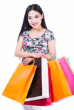 Young woman with shopping bags over white background Royalty Free Stock Photo