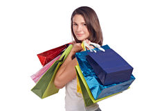 Young woman with shopping bags positive Royalty Free Stock Photos