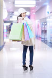 Young woman with shopping bags at shopping center Royalty Free Stock Photos