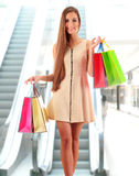 Young woman with shopping bags in shopping mall Stock Photo