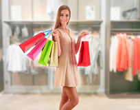 Young woman with shopping bags in shopping mall Royalty Free Stock Images