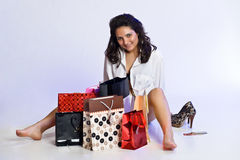Young woman among shopping bags Stock Images